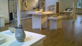 Scottish Potters - 40 Years, work by Anne Morrison (left) and Fiona Thompson (tables behind)